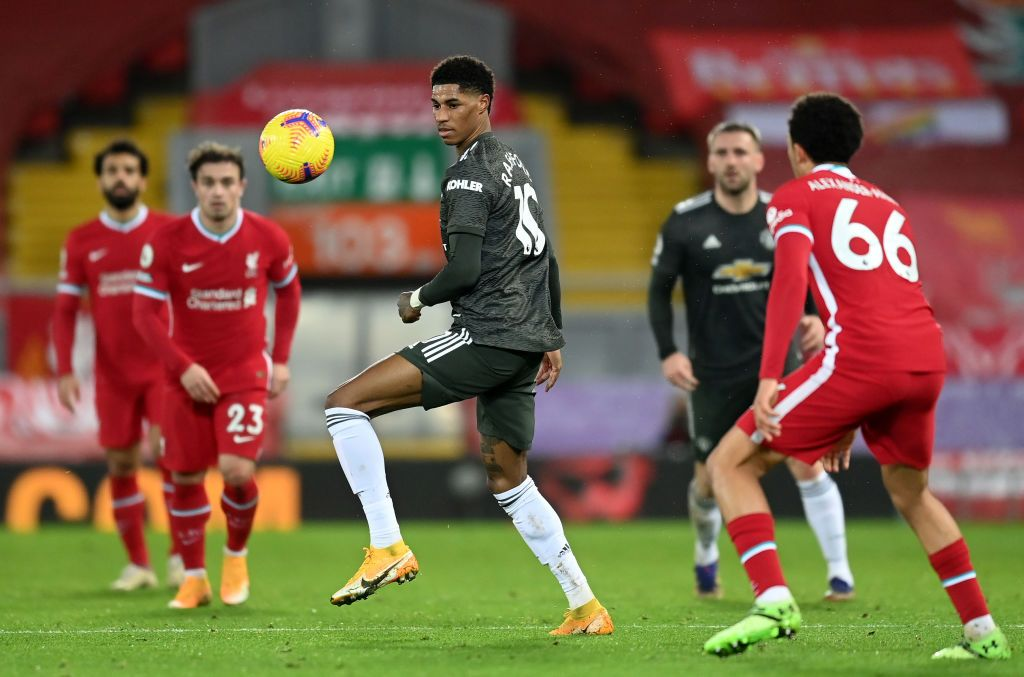 LIVERPOOL, ENGLAND - JANUARY 17: Marcus Rashford of Manchester United runs with the ball during the Premier League match between Liverpool and Manchester United at Anfield on January 17, 2021 in Liverpool, England. Sporting stadiums around England remain under strict restrictions due to the Coronavirus Pandemic as Government social distancing laws prohibit fans inside venues resulting in games being played behind closed doors. (Photo by Michael Regan/Getty Images)