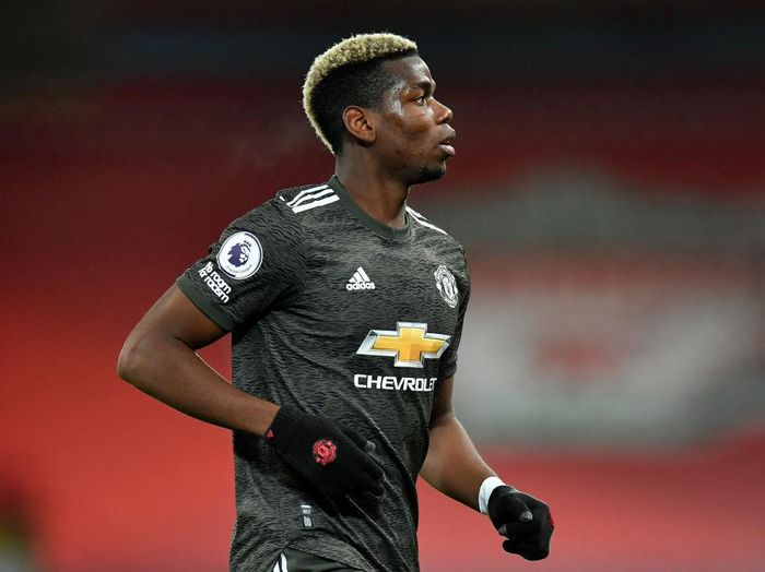 LIVERPOOL, ENGLAND - JANUARY 17: Paul Pogba of Manchester United in running action during the Premier League match between Liverpool and Manchester United at Anfield on January 17, 2021 in Liverpool, England. Sporting stadiums around England remain under strict restrictions due to the Coronavirus Pandemic as Government social distancing laws prohibit fans inside venues resulting in games being played behind closed doors. (Photo by Paul Ellis - Pool/Getty Images)