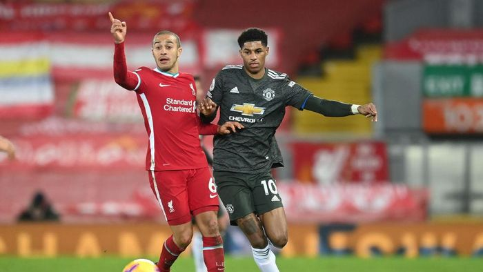 LIVERPOOL, ENGLAND - JANUARY 17: Marcus Rashford of Manchester United battles for possession with Thiago Alcantara of Liverpool during the Premier League match between Liverpool and Manchester United at Anfield on January 17, 2021 in Liverpool, England. Sporting stadiums around England remain under strict restrictions due to the Coronavirus Pandemic as Government social distancing laws prohibit fans inside venues resulting in games being played behind closed doors. (Photo by Michael Regan/Getty Images)