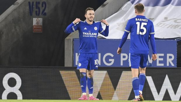 Leicester's James Maddison celebrates after scoring his team's second goal during the English Premier League soccer match between Leicester City and Chelsea at the King Power Stadium in Leicester, England, Tuesday, Jan. 19, 2021. (Michael Regan/Pool via AP)