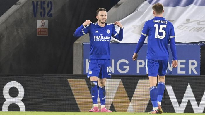 Leicesters James Maddison celebrates after scoring his teams second goal during the English Premier League soccer match between Leicester City and Chelsea at the King Power Stadium in Leicester, England, Tuesday, Jan. 19, 2021. (Michael Regan/Pool via AP)