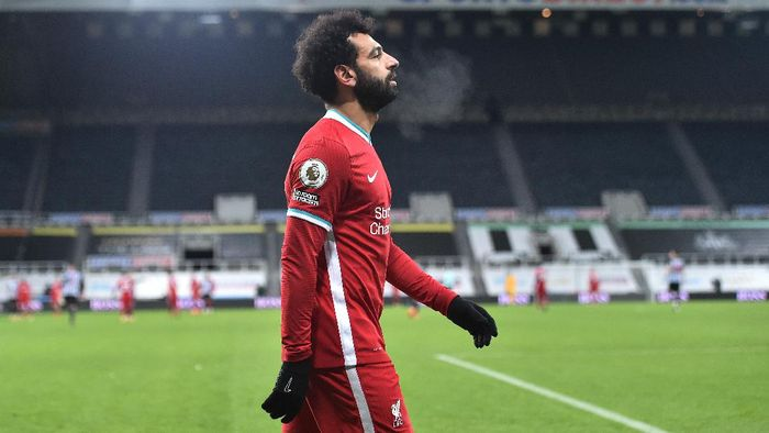 NEWCASTLE UPON TYNE, ENGLAND - DECEMBER 30: Mohamed Salah of Liverpool looks on during the Premier League match between Newcastle United and Liverpool at St. James Park on December 30, 2020 in Newcastle upon Tyne, England. The match will be played without fans, behind closed doors as a Covid-19 precaution. (Photo by Peter Powell - Pool/Getty Images)
