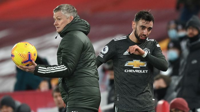 LIVERPOOL, ENGLAND - JANUARY 17: Ole Gunnar Solskjaer, Manager of Manchester United interacts with Bruno Fernandes of Manchester United after being substituted during the Premier League match between Liverpool and Manchester United at Anfield on January 17, 2021 in Liverpool, England. Sporting stadiums around England remain under strict restrictions due to the Coronavirus Pandemic as Government social distancing laws prohibit fans inside venues resulting in games being played behind closed doors. (Photo by Michael Regan/Getty Images)