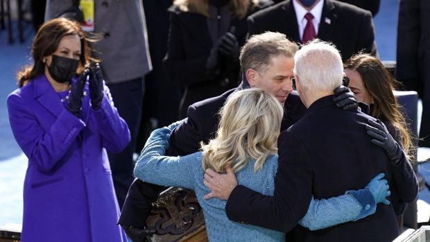 President Joe Biden is congratulated by first lady Jill Biden, his son Hunter Biden and daughter Ashley Biden after being sworn-in during the 59th Presidential Inauguration at the U.S. Capitol in Washington, Wednesday, Jan. 20, 2021. Vice President Kamala Harris applauds at left. (AP Photo/Carolyn Kaster)