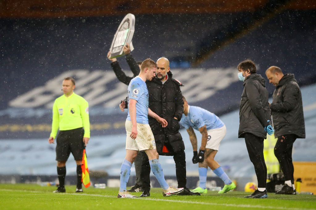 MANCHESTER, ENGLAND - JANUARY 20: Pep Guardiola, Manager of Manchester City greets Kevin De Bruyne of Manchester City off the pitch after he is substituted during the Premier League match between Manchester City and Aston Villa at Etihad Stadium on January 20, 2021 in Manchester, England. Sporting stadiums around the UK remain under strict restrictions due to the Coronavirus Pandemic as Government social distancing laws prohibit fans inside venues resulting in games being played behind closed doors. (Photo by Martin Rickett - Pool/Getty Images)