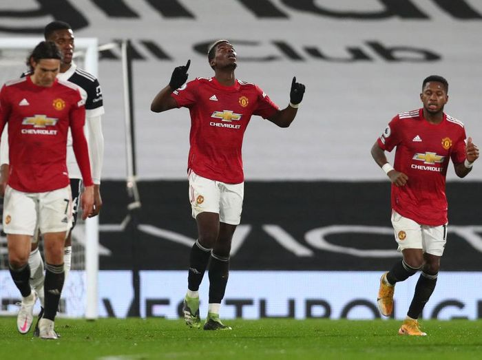 LONDON, ENGLAND - JANUARY 20: Paul Pogba of Manchester United celebrates after scoring their sides second goal during the Premier League match between Fulham and Manchester United at Craven Cottage on January 20, 2021 in London, England. Sporting stadiums around the UK remain under strict restrictions due to the Coronavirus Pandemic as Government social distancing laws prohibit fans inside venues resulting in games being played behind closed doors. (Photo by Clive Rose/Getty Images)