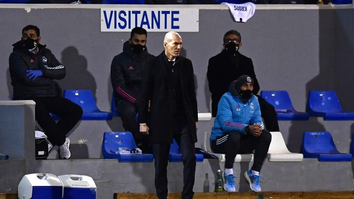 Real Madrids head coach Zinedine Zidane watches the play during a Spanish Copa del Rey round of 32 soccer match between Alcoyano and Real Madrid at the El Collao stadium in Alcoy, Spain, Wednesday Jan. 20, 2021. (AP Photo/Jose Breton)