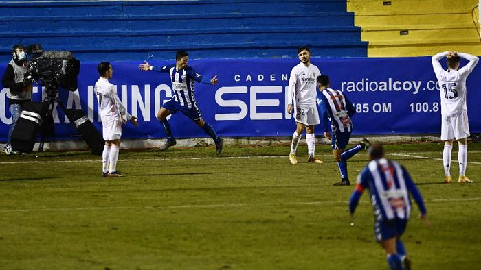 Alcoyanos Juanan, 2nd left, celebrates after scoring his sides second goal to knock out Real Madrid during a Spanish Copa del Rey round of 32 soccer match between Alcoyano and Real Madrid at the El Collao stadium in Alcoy, Spain, Wednesday Jan. 20, 2021. (AP Photo/Jose Breton)