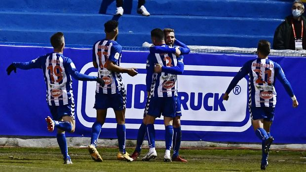 Alcoyano's Jose Solbes, centre celebrates with team mates after scoring the equaliser, his side's first goal during a Spanish Copa del Rey round of 32 soccer match between Alcoyano and Real Madrid at the El Collao stadium in Alcoy, Spain, Wednesday Jan. 20, 2021. (AP Photo/Jose Breton)