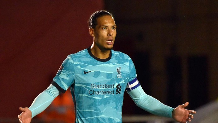 LINCOLN, ENGLAND - SEPTEMBER 24: Virgil van Dijk of Liverpool reacts during the Carabao Cup third round match between Lincoln City and Liverpool at Sincil Bank Stadium on September 24, 2020 in Lincoln, England. Football Stadiums around United Kingdom remain empty due to the Coronavirus Pandemic as Government social distancing laws prohibit fans inside venues resulting in fixtures being played behind closed doors. (Photo by Rui Vieira - Pool/Getty Images)