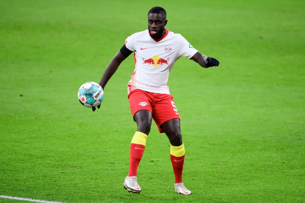 LEIPZIG, GERMANY - DECEMBER 19: Dayot Upamecano of RB Leipzig controls the ball during the Bundesliga match between RB Leipzig and 1. FC Koeln at Red Bull Arena on December 19, 2020 in Leipzig, Germany. Sporting stadiums around Germany remain under strict restrictions due to the Coronavirus Pandemic as Government social distancing laws prohibit fans inside venues resulting in games being played behind closed doors. (Photo by Oliver Hardt/Getty Images)