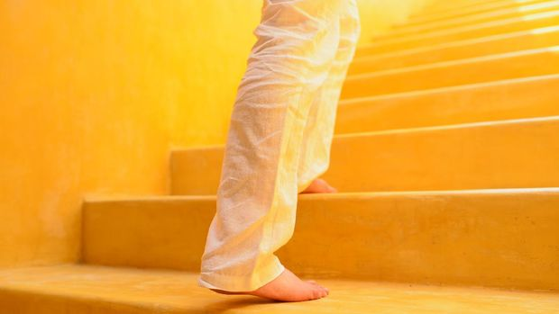 A man is climbing step by step with barefoot