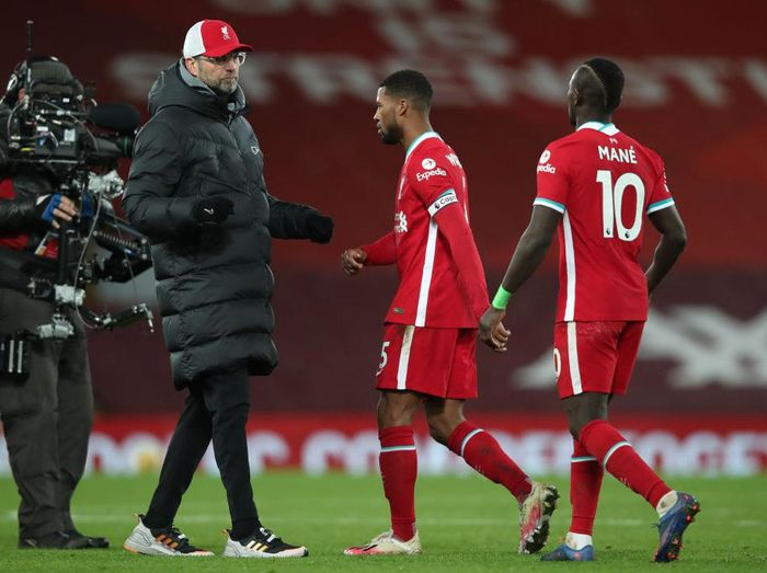 LIVERPOOL, ENGLAND - JANUARY 21: Jurgen Klopp, Manager of Liverpool interacts with Georginio Wijnaldum and Sadio Mane of Liverpool following the Premier League match between Liverpool and Burnley at Anfield on January 21, 2021 in Liverpool, England. Sporting stadiums around the UK remain under strict restrictions due to the Coronavirus Pandemic as Government social distancing laws prohibit fans inside venues resulting in games being played behind closed doors. (Photo by Clive Brunskill/Getty Images)
