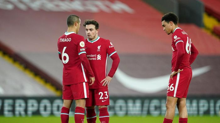 LIVERPOOL, ENGLAND - JANUARY 21: (L - R) Thiago Alcantara, Xherdan Shaqiri and Trent Alexander-Arnold of Liverpool prepare to take a free kick during the Premier League match between Liverpool and Burnley at Anfield on January 21, 2021 in Liverpool, England. Sporting stadiums around the UK remain under strict restrictions due to the Coronavirus Pandemic as Government social distancing laws prohibit fans inside venues resulting in games being played behind closed doors. (Photo by Jon Super - Pool/Getty Images)