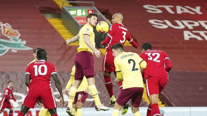 Players fight for the ball during the English Premier League soccer match between Liverpool and Burnley in Liverpool, England, Thursday, Jan. 21, 2021. (AP Photo/Jon Super, Pool)