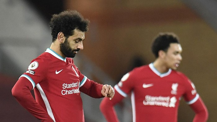 LIVERPOOL, ENGLAND - JANUARY 21: Mohamed Salah of Liverpool reacts after Ashley Barnes (Not pictured) of Burnley scores their sides first goal from the penalty spot during the Premier League match between Liverpool and Burnley at Anfield on January 21, 2021 in Liverpool, England. Sporting stadiums around the UK remain under strict restrictions due to the Coronavirus Pandemic as Government social distancing laws prohibit fans inside venues resulting in games being played behind closed doors. (Photo by Peter Powell - Pool/Getty Images)