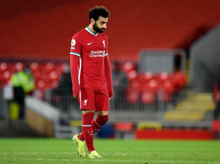 LIVERPOOL, ENGLAND - JANUARY 21: Mohamed Salah of Liverpool reacts during the Premier League match between Liverpool and Burnley at Anfield on January 21, 2021 in Liverpool, England. Sporting stadiums around the UK remain under strict restrictions due to the Coronavirus Pandemic as Government social distancing laws prohibit fans inside venues resulting in games being played behind closed doors. (Photo by Peter Powell - Pool/Getty Images)