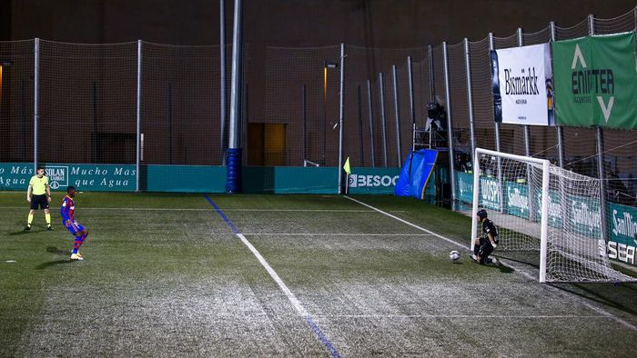 Barcelonas Ousmane Dembele attempts and fails to score a penalty shot during a Spanish Copa del Rey round of 32 soccer match between Cornella and FC Barcelona at the Nou Municipal stadium in Cornella, Spain, Thursday, Jan. 21, 2021. (AP Photo/Joan Monfort)