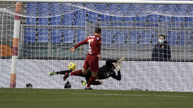 Roma's Borja Mayoral scores his side's opening goal during the Serie A soccer match between Roma and Spezia at the Rome Olympic Stadium Saturday, Jan. 23, 2021. (AP Photo/Gregorio Borgia)
