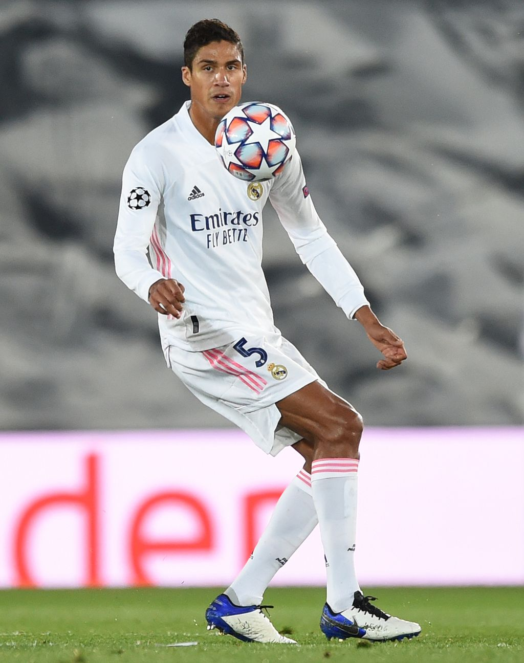 MADRID, SPAIN - OCTOBER 21: Raphael Varane of Real Madrid CF controls the ball during the UEFA Champions League Group B stage match between Real Madrid and Shakhtar Donetsk at Estadio Alfredo De Stefano on October 21, 2020 in Madrid, Spain. (Photo by Denis Doyle/Getty Images)
