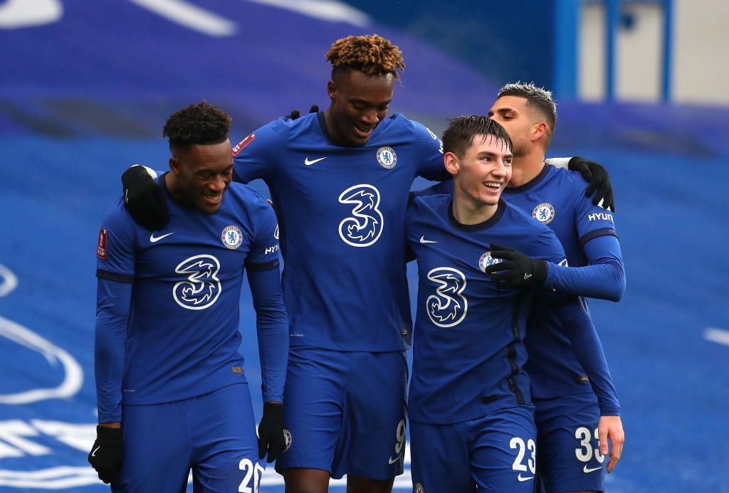 LONDON, ENGLAND - JANUARY 24: Tammy Abraham of Chelsea celebrates after scoring their sides third goal with team mates (L-R) Callum Hudson-Odoi, Billy Gilmour and Emerson during The Emirates FA Cup Fourth Round match between Chelsea and Luton Town at Stamford Bridge on January 24, 2021 in London, England. Sporting stadiums around the UK remain under strict restrictions due to the Coronavirus Pandemic as Government social distancing laws prohibit fans inside venues resulting in games being played behind closed doors. (Photo by Catherine Ivill/Getty Images)