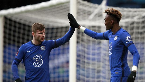 Chelsea's Tammy Abraham, right, celebrates with Chelsea's Timo Werner after scoring his side's second goal during the English FA Cup fourth round soccer match between Chelsea and Luton Town at Stamford Bridge Stadium in London, Sunday, Jan. 24, 2021. (AP Photo/Ian Walton)