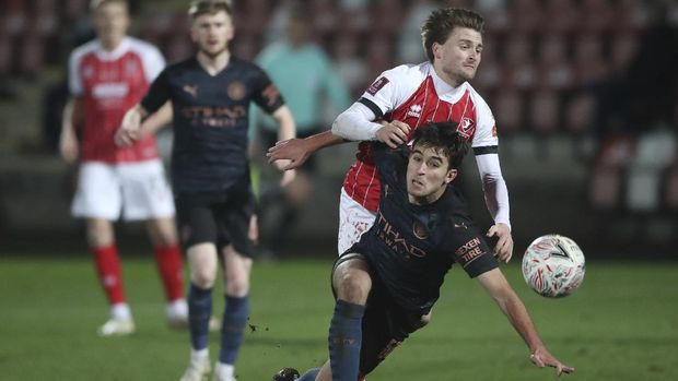 Cheltenham Town's Alfie May, collides with Manchester City's Eric Garcia who falls during the English FA Cup fourth round soccer match between Cheltenham Town and Manchester City at the Jonny-Rocks stadium in Cheltenham, England Saturday, Jan. 23, 2021. (Nick Potts /Pool via AP)
