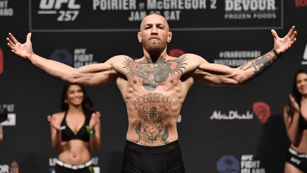 Jan 22, 2021; Abu Dhabi, UNITED ARAB EMIRATES;   Conor McGregor of Ireland poses on the scale during the UFC 257 weigh-in at Etihad Arena on UFC Fight Island on January 22, 2021 in Abu Dhabi, United Arab Emirates. Mandatory Credit: Jeff Bottari/Handout Photo via USA TODAY Sports