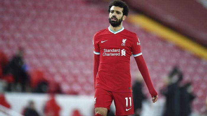 Liverpools Mohamed Salah walks dejected following the English Premier League soccer match between Liverpool and Burnley in Liverpool, England, Thursday, Jan. 21, 2021. Burnley won the match 0-1.(Peter Powell/Pool via AP)