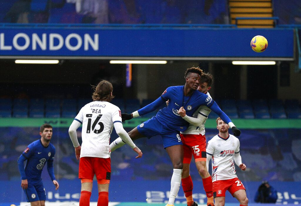 Chelsea's Tammy Abraham, third left, scores his side's second goal during the English FA Cup fourth round soccer match between Chelsea and Luton Town at Stamford Bridge Stadium in London, Sunday, Jan. 24, 2021. (AP Photo/Ian Walton)
