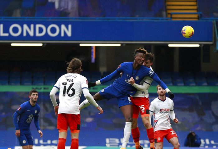 Chelseas Tammy Abraham, third left, scores his sides second goal during the English FA Cup fourth round soccer match between Chelsea and Luton Town at Stamford Bridge Stadium in London, Sunday, Jan. 24, 2021. (AP Photo/Ian Walton)