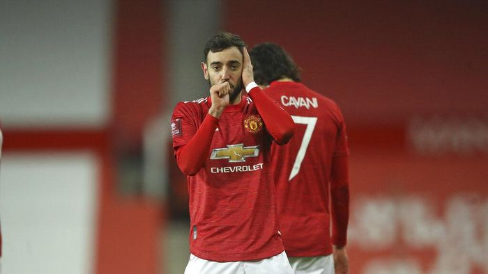 Manchester Uniteds Bruno Fernandes celebrates after scoring his sides third goal during the English FA Cup 4th round soccer match between Manchester United and Liverpool at Old Trafford in Manchester, England, Sunday, Jan. 24, 2021. (Martin Rickett/Pool via AP)
