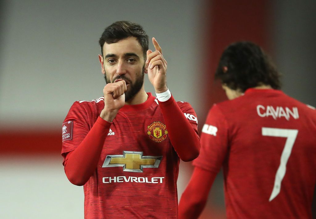 MANCHESTER, ENGLAND - JANUARY 24: Bruno Fernandes of Manchester United celebrates after scoring their sides third goal from a free kick during The Emirates FA Cup Fourth Round match between Manchester United and Liverpool at Old Trafford on January 24, 2021 in Manchester, England. Sporting stadiums around the UK remain under strict restrictions due to the Coronavirus Pandemic as Government social distancing laws prohibit fans inside venues resulting in games being played behind closed doors. (Photo by Martin Rickett - Pool/Getty Images)