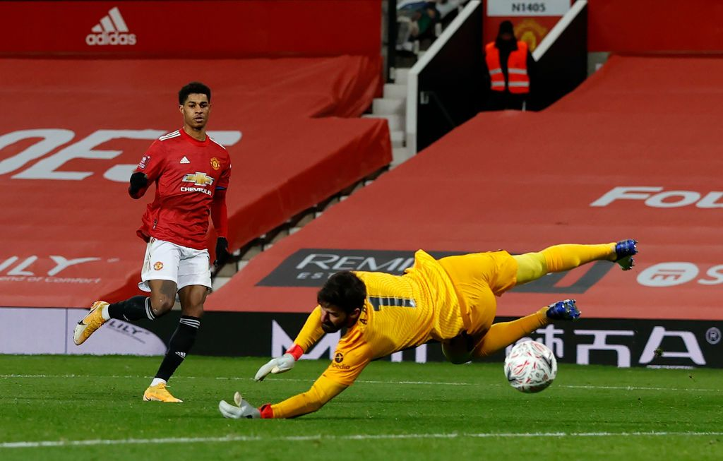 MANCHESTER, ENGLAND - JANUARY 24: Marcus Rashford of Manchester United celebrates after scoring their side's second goal during The Emirates FA Cup Fourth Round match between Manchester United and Liverpool at Old Trafford on January 24, 2021 in Manchester, England. Sporting stadiums around the UK remain under strict restrictions due to the Coronavirus Pandemic as Government social distancing laws prohibit fans inside venues resulting in games being played behind closed doors. (Photo by Martin Rickett - Pool/Getty Images)