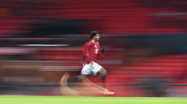 Manchester United's Marcus Rashford races after the ball during the English FA Cup 4th round soccer match between Manchester United and Liverpool at Old Trafford in Manchester, England, Sunday, Jan. 24, 2021. (Laurence Griffiths/Pool via AP)