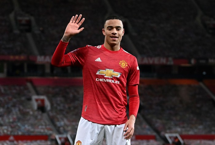 MANCHESTER, ENGLAND - JANUARY 24: Mason Greenwood of Manchester United celebrates after scoring their sides first goal  during The Emirates FA Cup Fourth Round match between Manchester United and Liverpool at Old Trafford on January 24, 2021 in Manchester, England. Sporting stadiums around the UK remain under strict restrictions due to the Coronavirus Pandemic as Government social distancing laws prohibit fans inside venues resulting in games being played behind closed doors. (Photo by Laurence Griffiths/Getty Images)