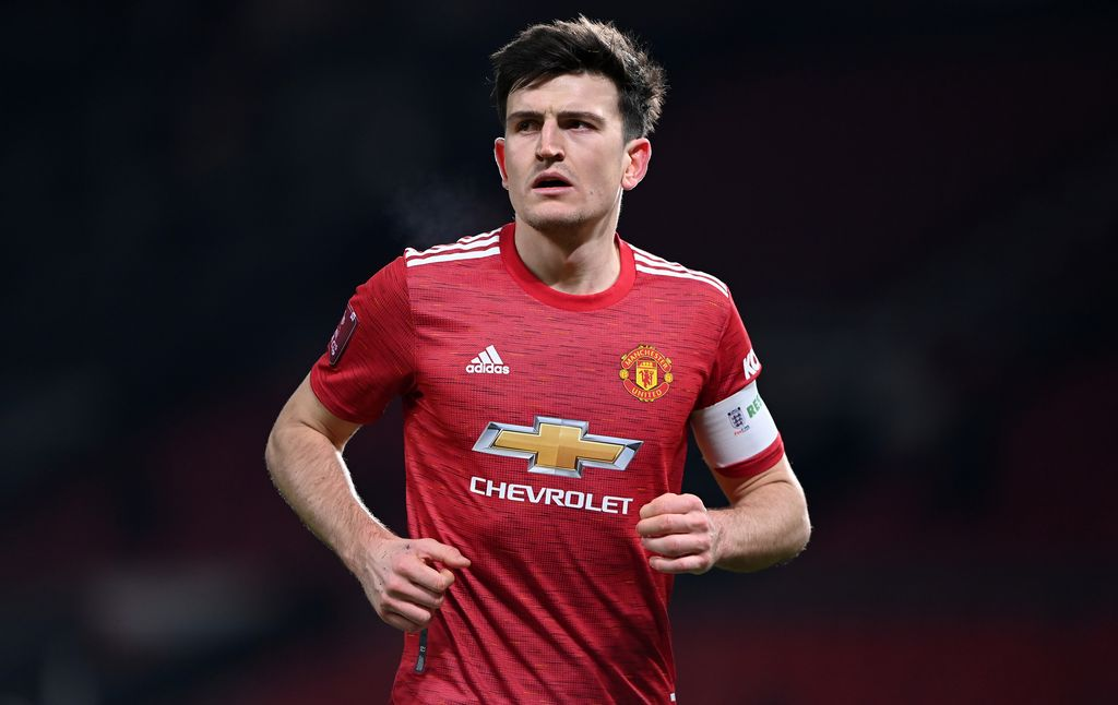 MANCHESTER, ENGLAND - JANUARY 24: Harry Maguire of Manchester United looks on during The Emirates FA Cup 4th Round match between Manchester United and Liverpool at Old Trafford on January 24, 2021 in Manchester, England. Sporting stadiums around the UK remain under strict restrictions due to the Coronavirus Pandemic as Government social distancing laws prohibit fans inside venues resulting in games being played behind closed doors. (Photo by Laurence Griffiths/Getty Images)