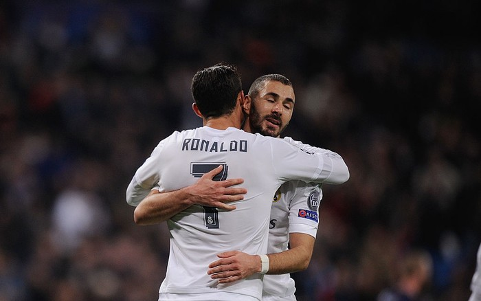 MADRID, SPAIN - DECEMBER 08:  Cristiano Ronaldo of Real Madrid celebrates with Karim Benzema after scoring Reals 6th goal during the UEFA Champions League Group A match between Real Madrid CF and Malmo FF at the Santiago Bernabeu stadium on December 8, 2015 in Madrid, Spain.  (Photo by Denis Doyle/Getty Images)