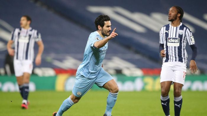 WEST BROMWICH, ENGLAND - JANUARY 26: Ilkay Guendogan of Manchester City celebrates after scoring their teams firs goal  during the Premier League match between West Bromwich Albion and Manchester City at The Hawthorns on January 26, 2021 in West Bromwich, England. Sporting stadiums around the UK remain under strict restrictions due to the Coronavirus Pandemic as Government social distancing laws prohibit fans inside venues resulting in games being played behind closed doors. (Photo by Nick Potts - Pool/Getty Images)