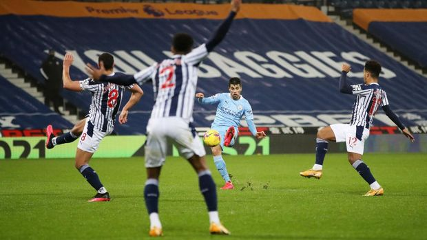 WEST BROMWICH, ENGLAND - JANUARY 26: Joao Cancelo of Manchester City scores their team's second goal during the Premier League match between West Bromwich Albion and Manchester City at The Hawthorns on January 26, 2021 in West Bromwich, England. Sporting stadiums around the UK remain under strict restrictions due to the Coronavirus Pandemic as Government social distancing laws prohibit fans inside venues resulting in games being played behind closed doors. (Photo by Nick Potts - Pool/Getty Images)