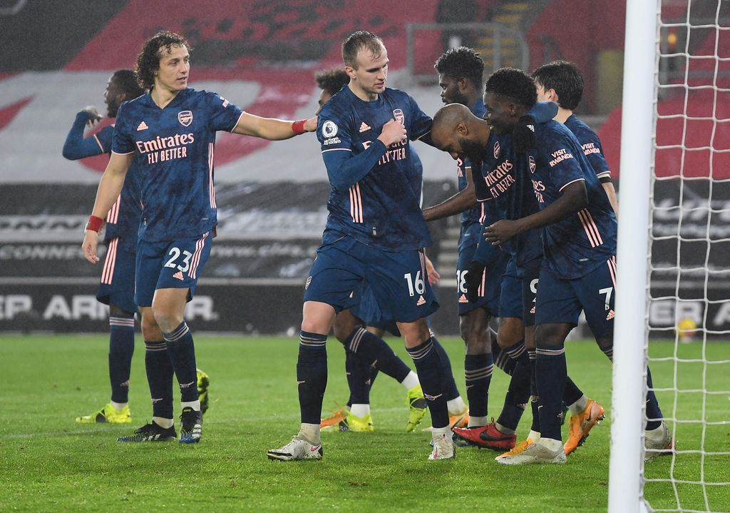 SOUTHAMPTON, ENGLAND - JANUARY 26: Alexandre Lacazette of Arsenal celebrates with Rob Holding and Bukayo Saka after scoring their team's third goal during the Premier League match between Southampton and Arsenal at St Mary's Stadium on January 26, 2021 in Southampton, England. Sporting stadiums around the UK remain under strict restrictions due to the Coronavirus Pandemic as Government social distancing laws prohibit fans inside venues resulting in games being played behind closed doors. (Photo by Andy Rain - Pool/Getty Images)