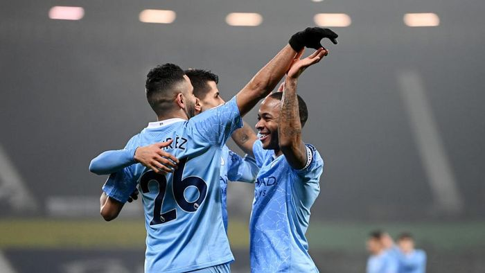 WEST BROMWICH, ENGLAND - JANUARY 26: Raheem Sterling of Manchester City celebrates with Riyad Mahrez and Rodri after scoring their teams fifth goal during the Premier League match between West Bromwich Albion and Manchester City at The Hawthorns on January 26, 2021 in West Bromwich, England. Sporting stadiums around the UK remain under strict restrictions due to the Coronavirus Pandemic as Government social distancing laws prohibit fans inside venues resulting in games being played behind closed doors. (Photo by Laurence Griffiths/Getty Images)