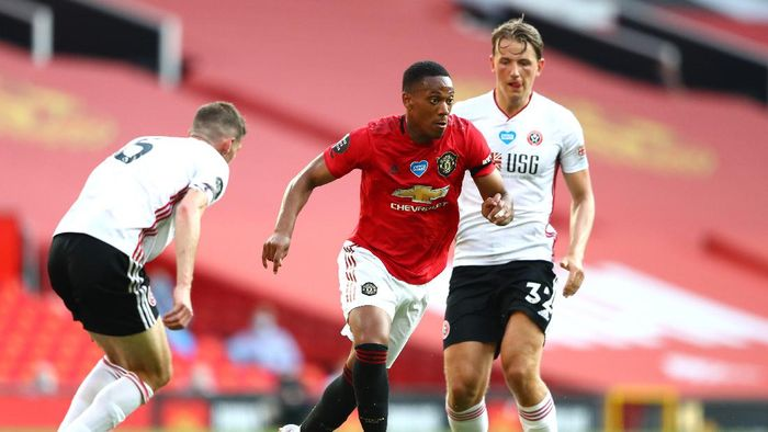 MANCHESTER, ENGLAND - JUNE 24: Anthony Martial of Manchester United is challenged by Phil Jagielka and Sander Berge of Sheffield United during the Premier League match between Manchester United and Sheffield United at Old Trafford on June 24, 2020 in Manchester, England. (Photo by Michael Steele/Getty Images)
