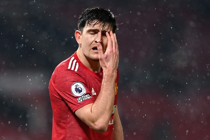 MANCHESTER, ENGLAND - JANUARY 27: Harry Maguire of Manchester United reacts during the Premier League match between Manchester United and Sheffield United at Old Trafford on January 27, 2021 in Manchester, England. Sporting stadiums around the UK remain under strict restrictions due to the Coronavirus Pandemic as Government social distancing laws prohibit fans inside venues resulting in games being played behind closed doors. (Photo by Laurence Griffiths/Getty Images)