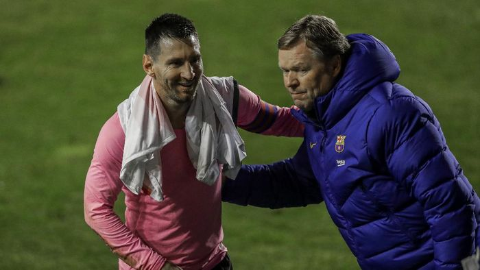 Barcelonas Lionel Messi, left, and Barcelonas head coach Ronald Koeman celebrate after winning a Spanish Copa del Rey round of 16 soccer match against Rayo Vallecano at the Vallecas stadium in Madrid, Spain, Wednesday, Jan. 27, 2021. (AP Photo/Manu Fernandez)