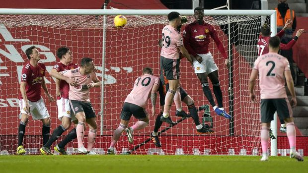MANCHESTER, ENGLAND - JANUARY 27: Kean Bryan of Sheffield United scores their side's first goal during the Premier League match between Manchester United and Sheffield United at Old Trafford on January 27, 2021 in Manchester, England. Sporting stadiums around the UK remain under strict restrictions due to the Coronavirus Pandemic as Government social distancing laws prohibit fans inside venues resulting in games being played behind closed doors. (Photo by Tim Keeton -