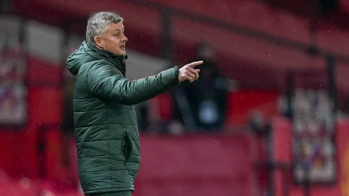 Manchester Uniteds manager Ole Gunnar Solskjaer gestures during the English Premier League soccer match between Manchester United and Sheffield United at Old Trafford, Manchester, England, Wednesday, Jan. 27, 2021. (AP Photo/Tim Keeton,Pool)