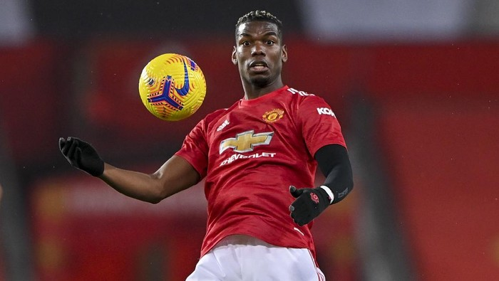 Manchester Uniteds Paul Pogba attempts to control the ball during the English Premier League soccer match between Manchester United and Sheffield United at Old Trafford, Manchester, England, Wednesday, Jan. 27, 2021. (AP Photo/Laurence Griffiths,Pool)