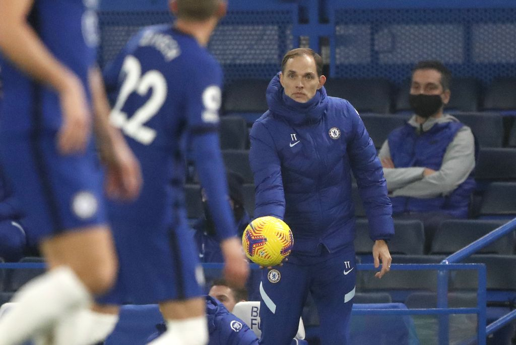 Chelsea's new head coach Thomas Tuchel holds the ball during the English Premier League soccer match between Chelsea and Wolverhampton Wanderers at Stamford Bridge Stadium in London, England, Wednesday, Jan. 27, 2021. (AP Photo/Frank Augstein)