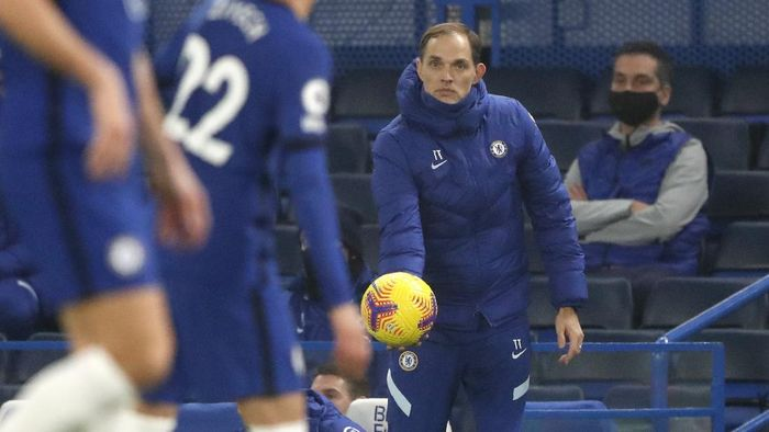 Chelseas new head coach Thomas Tuchel holds the ball during the English Premier League soccer match between Chelsea and Wolverhampton Wanderers at Stamford Bridge Stadium in London, England, Wednesday, Jan. 27, 2021. (AP Photo/Frank Augstein)